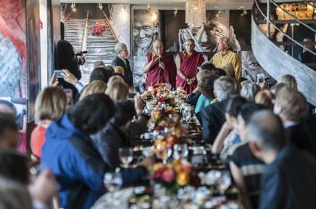 The Dalai Lama addresses a gathering at the home of Bobby Sager (standing, at right).