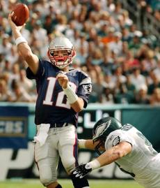 Tom Brady threw three touchdown passes against the Eagles.