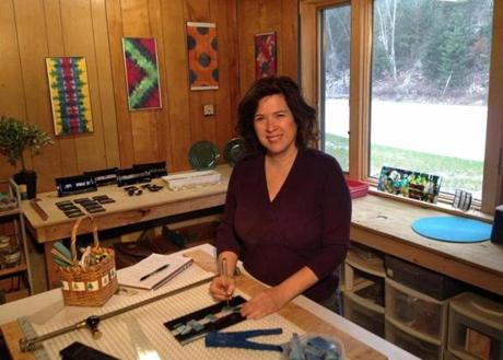 Eve Passeltiner makes fused glass art in her wood-heated home studio in South Wheelock, VT.