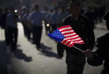 Boston's Veterans Day Parade wound its way from the Boston Common to City Hall, where it culminated in speeches and music. Nov. 11, 2012.