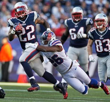 Ridley gained some yardage as the Bills' Justin Rogers tried to bring him down from behind.