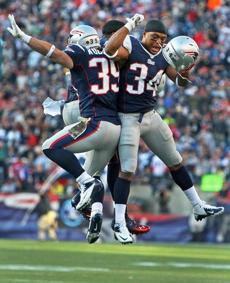 Woodhead (39), Ridley (hidden) and Shane Vereen  leaped in celebration after Woodhead's third-quarter touchdown.