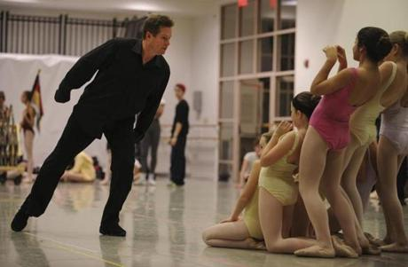 Boston Ballet artistic director Mikko Nissinen showed young dancers the reaction he expects from them as he ran through the actions of the Mouse King during a scene rehearsal on November 9.