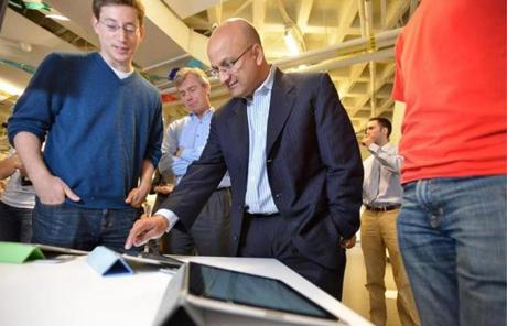 Nitin Hohria (center), dean of Harvard Business School, looked at a presentation about a student's project, Schoolyourself.org.