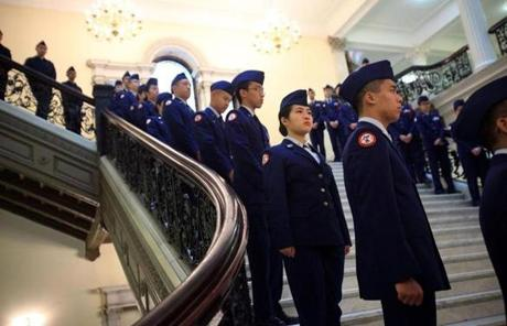 Students from the North Quincy High School ROTC program lined the grand staircase at the State House.