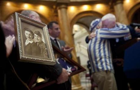Stephan Ross, of Boston, a Holocaust survivor, met for the first time the family of the late soldier, Lt. Steven Sattler, who gave him food and a small American Flag during the liberation of Dachau.