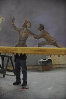 Workers put final touches on a fresco border for the palace scene at Mystic Scenic Studios, Inc in Norwood on October 17.