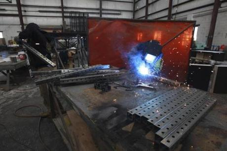 Welder Bobby Bou worked on cable diverters used to lift lines at Mystic Scenic Studios, Inc in Norwood on October 17.