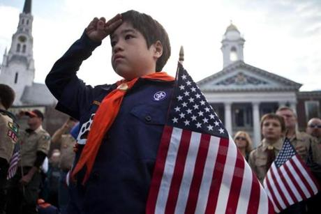 Left: Christopher McDonald, 7, salutes the American flag during the Veterans Day ceremony on the Woburn Common Sunday, Nov. 11.