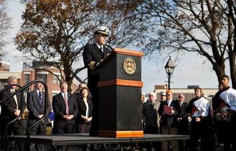 About 4,000 people were expected at the dedication, which was held after the city's regular Veterans Day ceremony and parade. Speakers at the dedication included Navy Capt. Francis S. O'Connor (left), the highest active duty military person from Woburn. O'Connor, a veteran of the Afghanistan and Iraq wars, is listed on the monument.