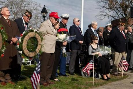 Members of The Friends of Woburn Veterans Committee listen to the speakers during the Veterans Day ceremony on Woburn Common preceding the unveiling of the new War Memorial on Sunday.