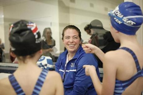 Coach Kristen Powers (center) chatted with Julia Gallo (left) and Eleanor Mackey (right) and prior to water polo practice at the Charles River YMCA in Needham,