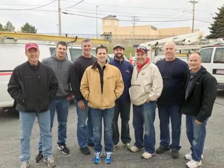 Some of the Verizon techs who left from the company's Methuen garage Friday.