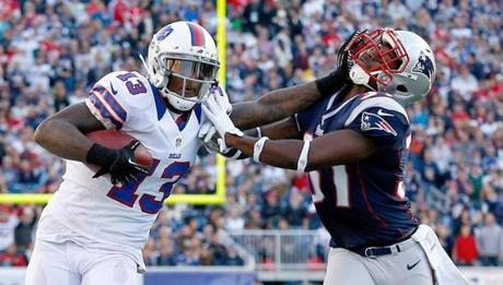 Stevie Johnson stiff-armed Patriots cornerback Alfonzo Dennard in the second half.