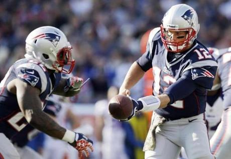 Patriots quarterback Tom Brady handed off to running back Stevan Ridley during the first quarter.