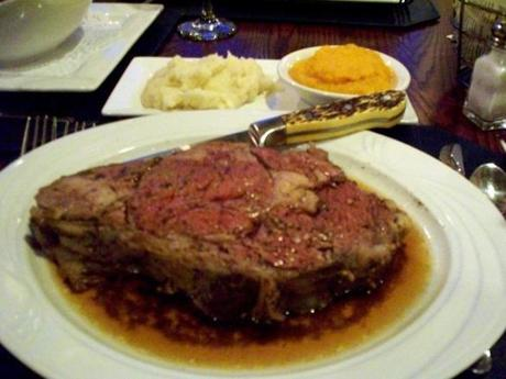 "The restaurant's ""King cut"" of roast prime rib is accompanied by several side dishes, including a choice of Delmonico, baked, or mashed potatoes, and arrived with just the right hint of pink, as ordered."