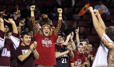 11/13/12 Amherst, MA: UMASS hosted Harvard University in a 10 AM college basketball game at the Mullins Center on the UMASS campus. Here UMASS fans get