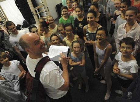 Boston Ballet faculty member Chris Anderson called roll with children on November 9 before they went into the studio to rehearse.