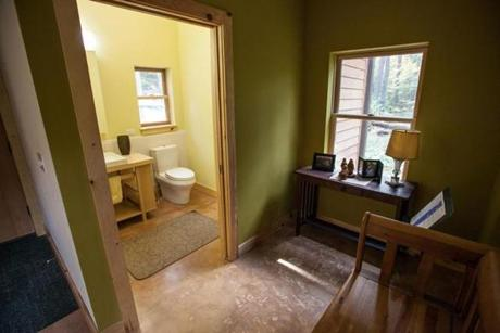 The bathroom is more spacious so a wheechair-bound person could function more easily.