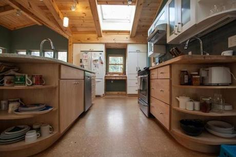 Wider spaces between counters and rounded corner cabinets help aid wheelchair maneuverability.