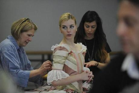 Kim Vercoe (left) and Sara Marhamo, both first hands with the Boston Ballet's costume shop, helped dancer Whitney Jensen as she got fitted with her new costume on November 8.