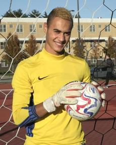 Weymouth High junior and starting goalie of the boys soccer team, Lucas Rezende-Verge posed on the soccer field.