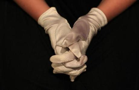 Girls who participated at Boston Assemblies in Hingham as part of social dance and etiquette instruction wore gloves with their party attire.
