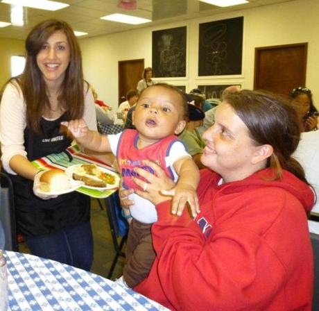Danielle Metz is a Wegmans Food Market employee who volunteered at the United Way of Tri-County's Pearl Street Cupboard & Café in Framingham this fall. She is serving customer Heather Carter and her son Damarcus, from Framingham.