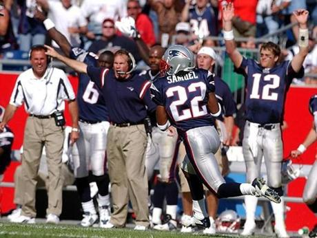 The Patriots sideline cheered as Asante Samuel returned an interception 55 yards for a touchdown.