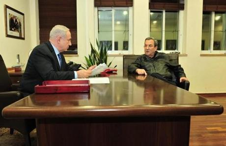 Israeli Prime Minister Benjamin Netanyahu and Defense Minister Ehud Barak speak in Netanyahu's office. Barak authorized the call-up of 30,000 army reservists if needed.