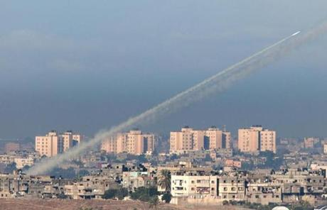 A rocket launched from Gaza as seen from the Israeli city of Sderot Thursday. An Israeli official said 300 rockets were fired into southern Israel and at least 130 more had been intercepted by Israel's Iron Dome antimissile defense system.