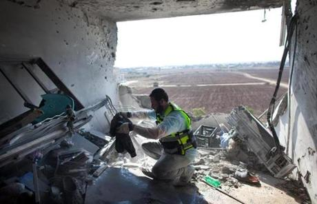 An Israeli Zaka emergency services volunteer worked in a Kiryat Malachi apartment  where three Israelis died after being hit by a rocket fired by Palestinian militants Thursday.
