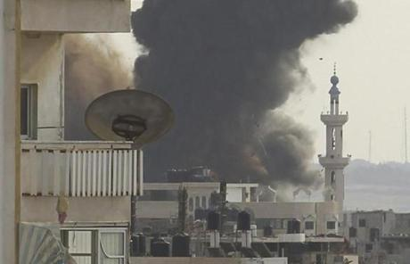 Smoke rose in Gaza City after Israeli air strikes Friday. Officials in Gaza said 19 people, including five children and a pregnant teenager, were killed over Wednesday and Thursday.