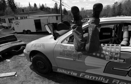 Groveton, N.H., 05-13-11- Nick Gilcris (cq) helps secure 19-year-old Ashleigh Roy's (cq) seat in her racing car before opening day at the Gilcris family's garage. Recalling his first race when he was 12 he says,