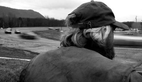 Groveton, N.H. 11-3-12 - Billy Hennequin (cq) of Johnson, VT watches the 200-lap Enduro race at Riverside Speedway. The quarter mile race track, which opened in 1964, attracts racers and fans from across northern New England. According to Melinda Kennett (cq) Groveton's town clerk, the track