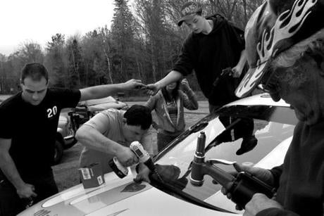 Groveton, N.H., 05-14-11- The Gilchris family racing team helps out teen racer Ashleigh Roy, (cq) finishing up her car in time for opening day. For the Gilcris family, allowing Nick to race is an incentive for him to finish high school. His grandmother Rosie Gilcris (cq) says,