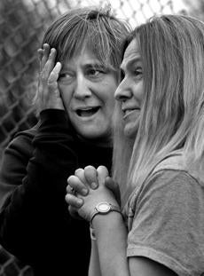 Groveton, N.H., 05-14-11- l-r A worried wife Janet Smith, (cq) and mother Brenda Mitchell, (cq), watch a practice run at the Riverside Speedway the day before opening day. Mitchell whose 11-year-old son Cody was on the track says of him racing,