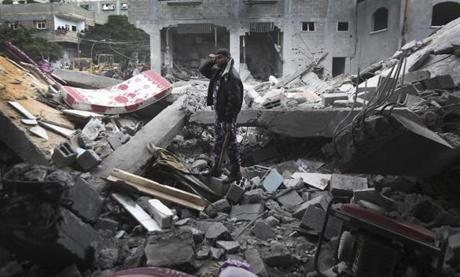 A Palestinian searched for victims under the rubble of the destroyed house of a Hamas official after an Israeli air strike on a refugee camp in the northern Gaza Strip on Saturday.