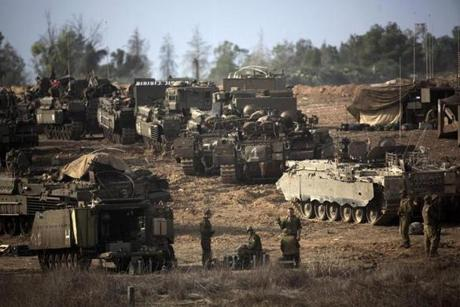 Israeli soldiers took position on Israel's border with the Gaza Strip on Saturday.