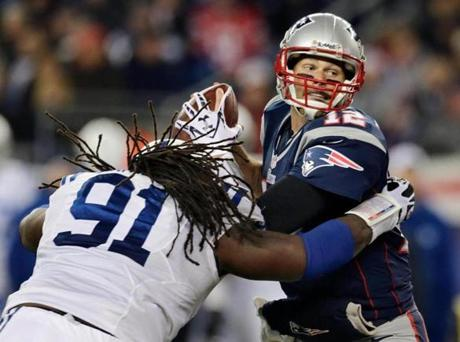 Brady eluded Colts defensive end Ricardo Mathews  to get a pass off during the second quarter.