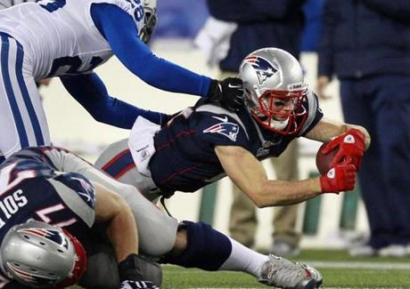 Julian Edelman, who had 222 all-purpose yards, advanced downfield Colts safety Tom Zbikowski tried to make a tackle in the first quarter.