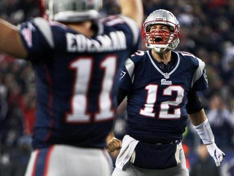 11/18/12 Foxborough, MA: FOURTH QUARTER........Patriots quarterback Tom Brady (12) howls in delight, and wide reciever Julian Edelman (11,left) signals