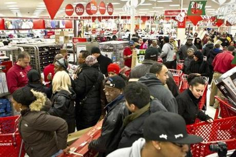 Shoppers congregated in the electronics section of Target in South Bay Center in Dorchester after its 4:00 a.m. opening.