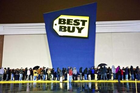 Shoppers waited outside in the rain for the store to open during Black Friday in South Bay Center in Dorchester.