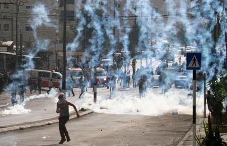 A Palestinian ran from tear gas fired by Israeli forces in Bethlehem in the West Bank.