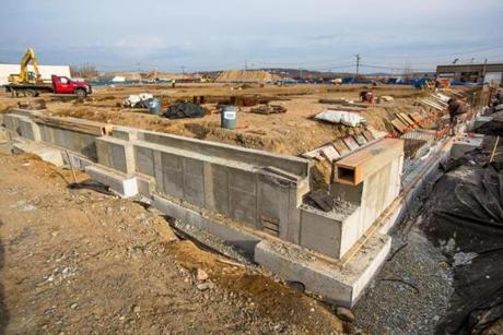 Workers have begun construction at the site of a proposed Market Basket near Northgate Shopping Center in Revere.