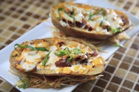 Bacon and cheese potato skins (with potato still filling the skins).