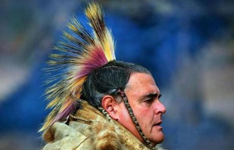 Indian interpreter Bob Charlebous wore a headdress he made from porcupine and deer hair dyed with red berries patterned after the crest of a woodpecker.