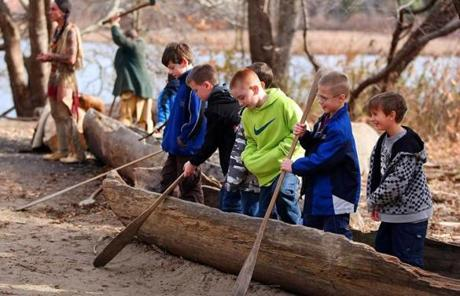 At the Wampanoag Homesite, students from the Black Rock School in Coventry, R.I., checked out a hand-carved canoe.