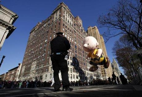 The Charlie Brown balloon floated down Central Park West during the 86th Macy's Thanksgiving Day Parade in New York.
